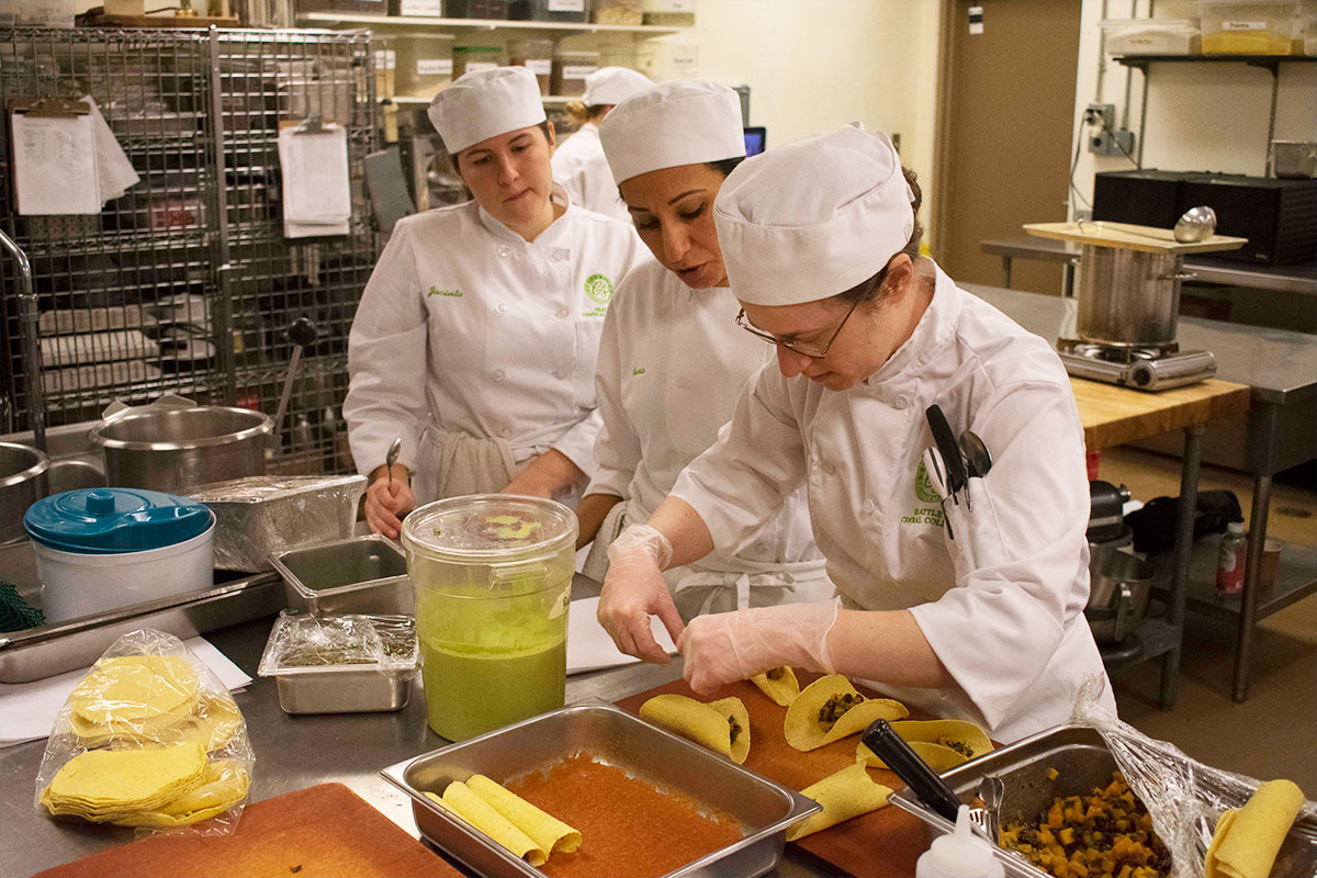 culinary students cooking in healthcare competition