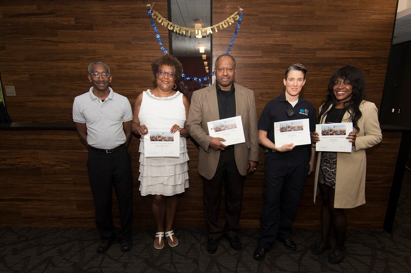 Annie John, Brian Kirk, Marian Lyles, Sharon Spence-Wilcox, and Tracy Yorker receive awards
