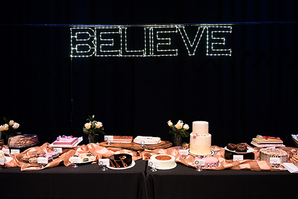 Believe is spelled out in lights over the desert dash table