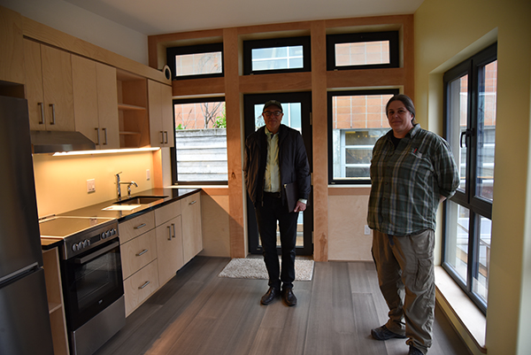 Catie Chaplan and Joe Giampietro show off the Mini Zeph house kitchen