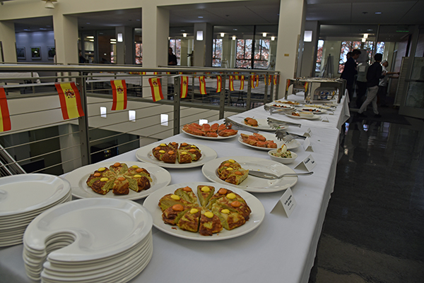 a food table display shows of Spanish tortilla and other tapas